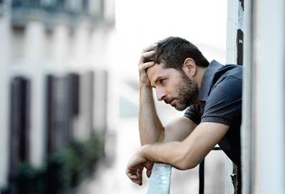 Young Man At Balcony In Depression Suffering Emotional Crisis An