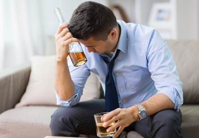 alcoholism, alcohol addiction and people concept - male alcoholi